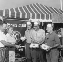 Image of Western Days - Kiwanis Club sells fruitcake as a charitable event.