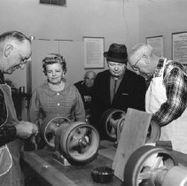 Image of Woodworking - Visitors watch woodworking at work.