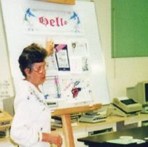 Image of Computers - Gisele Bresser teaching a session on graphics for the Apple MacIntosh Computer Club.