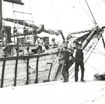 Image of Ship at dock with marsh grass - Print, Photographic