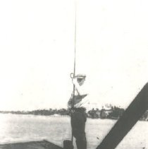 Image of Lone man on stern of ship - Print, Photographic