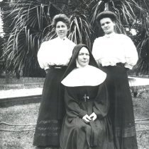 Image of Sister Catherine with two young girls - Print, Photographic