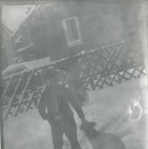 Image of Boy with dog in snow - Print, Photographic
