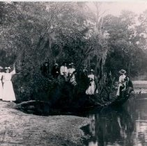 Image of Group of people at river bank - Print, Photographic