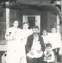Image of Family scene, six children and two adults - Print, Photographic