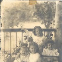 Image of Four Waas children on porch - Print, Photographic