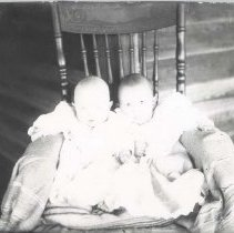 Image of Two babies in rocking chair - Print, Photographic