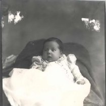 Image of baby in draped chair -James Da