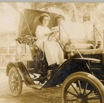 Image of Flossie Borden driving her car - Print, Photographic