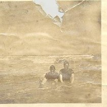 Image of Two Men in surf. - Print, Photographic