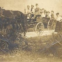 Image of Group of people on wagon - Print, Photographic