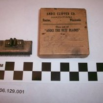 Image of cardboard box and metal clippers - Box