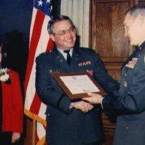 Image of Yates receiving Merit