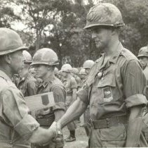 Image of Devoe receiving the Bronze Star Medal