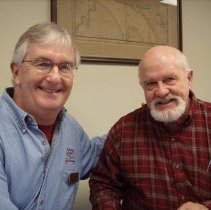 Image of Carter with interviewer, Robert Hamer