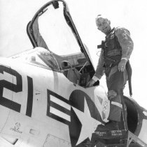 Image of Carter boarding Naval plane in 1962