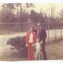 Image of Brooks with wife and son in jail yard