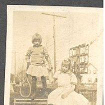Image of Two girls on a bench - Print, Photographic