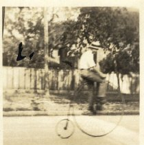 Image of Man on bicycle - Print, Photographic