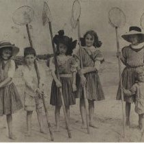 Image of Children on the beach with crab nets - Print, Photographic