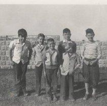 Image of Boys standing near construction of Seaside Inn