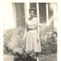 Image of Adeline Brooks Davis with a dog - Print, Photographic