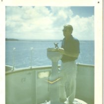 Image of George T Davis aboard an unknown vessel