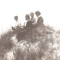 Image of Four women on a dune at the beach - Print, Photographic