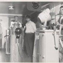 Image of Captain Davis piloting a large vessel. - Print, Photographic