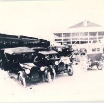 Image of Casino on the beach with cars. - Print, Photographic
