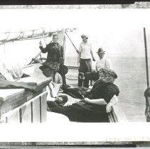 Image of Pilots and families on the stern of a pilot boat. - Print, Photographic