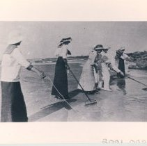 Image of Group of people crabbing on the beach. - Print, Photographic