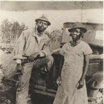 Image of Mr. and Mrs. James Hill with their car   - Print, Photographic