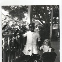 Image of Child with doll in Carriage - Print, Photographic