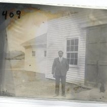Image of Unknown man by Stafford barn - Print, Photographic