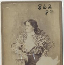 Image of Seated woman looking to side - Print, Photographic