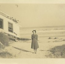 Image of Women in a dress on the beach - Postcard, Picture