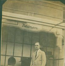 Image of Man standing in front of his store? - Print, Photographic