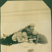 Image of The Millikins lounging on the beach - Print, Photographic