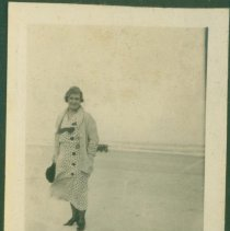 Image of Mother standing on the beach.