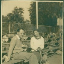Image of Gordon and Dorothy, with Laura's shadow, on the bleachers.