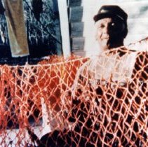 Image of James W. Delaney with shrimp net - Print, Photographic