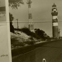 Image of Lighthouse and radar tower beside road