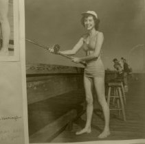 Image of Phyllis Kennington fishing on pier