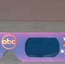 """Image of 3-D Glasses - One transparent blue lens and one transparent red lens.  Decoration fro m earpiece to to earpiece is a wavy pattern in blue and fuschia colors.  Proper left earpiece reads left to right, """"WENDY'S NEW FRESH / Stuffed / Pitas.""""  Center reads, """"Watch / ABC / in 3-D.""""  Between lenses in middle is, """"abc"""" in a circle.  Proper right """"Watch / ABC / in 3-D.""""  Proper right earpiece reads: Coming at you in May!""""  Back of earpieces are white while the centerpiece is black with white letters between the lenses that reads, """"THIS SIDE / TOWARDS FACE."""""""