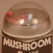 """Image of """"Mushroom #4"""" Game - Game box: black and white cardboard in plastic wrapping.  Game: Clear plastic. 9 plastic balls: 3 green, 3 orange, and 3 pink."""