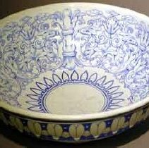 Image of Basin - Basin: High glaze crockery wash bowl, white with cobalt blue floral and swirl design around center. Design is appliqued and under glaze. Hearts around top edge.