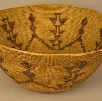 Image of Basket - Basket: 3 tiered diamond design with other design that forms a 5 pointed star design in center. Design done in natural dark grass. Basket's color is natural light color.