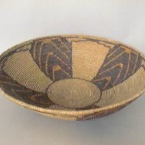 Image of Basket - Coiled basket made of sumac, rose bud, and fern, decorated with 4 triangular rays of black fern with red bud triangles.  Rays come from central circle.