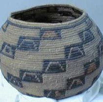Image of Basket - Coiled willow and grasses basket decorated with diagonal rhombohendrons from bottom to rim. Design is black with some red and white.
